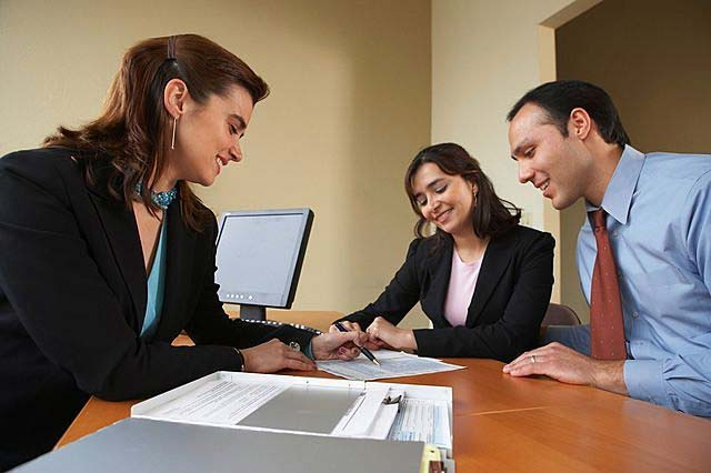 real estate agent meeting clients
