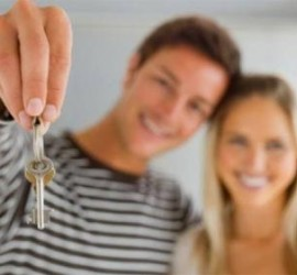 New homeowners with house keys